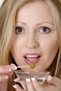 Attractive woman having a martini Stock Photo