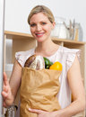 Attractive woman holding a grocery bag Stock Images