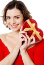 Attractive woman holding valentine gift beautiful young wrapped box Stock Image