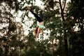 Attractive woman jumping masterfully and performs trick upside down in the air Royalty Free Stock Photo