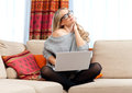 Attractive woman with laptop having neck pain Royalty Free Stock Photos