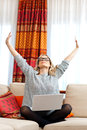 Attractive woman with laptop in home Royalty Free Stock Photos