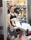 Attractive woman lifting weights with a leg press Royalty Free Stock Photo