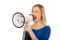 Attractive woman with megaphone. Royalty Free Stock Photo