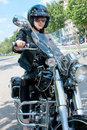 Attractive woman  on a  motorbike Royalty Free Stock Image
