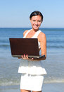 Attractive woman with notebook on the beach Royalty Free Stock Images