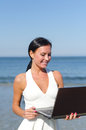 Attractive woman with notebook on the beach place for text Royalty Free Stock Image