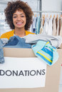 Attractive woman participating at charity and holding donation box Royalty Free Stock Photography