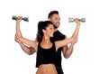 Attractive woman and a personal trainer women with weight training Royalty Free Stock Image