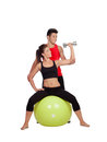 Attractive woman and a personal trainer women with weight training Royalty Free Stock Photos