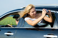 Attractive woman photographing from car window Stock Photos