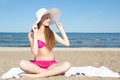 Attractive woman in pink swimsuit sitting on the beach young Stock Photos