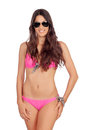 Attractive woman with pink swimwear and sunglasses isolated on a white background Stock Images