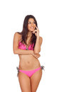 Attractive woman with pink swimwear thinking isolated on a white background Royalty Free Stock Photo