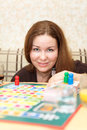 Attractive woman playing board game Stock Photos