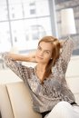 Attractive woman posing on couch Royalty Free Stock Photo