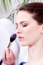 Attractive woman powder face make up cosmetic beauty salon Stock Photo