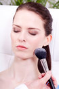 Attractive woman powder face make up cosmetic beauty salon Royalty Free Stock Photo