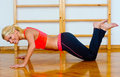 Attractive woman in push up position gym working on ups Royalty Free Stock Image