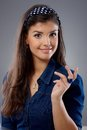 Attractive woman with questioning look young smiling Royalty Free Stock Image