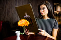 Attractive woman reading the menu at restaurant Stock Image