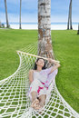 Attractive woman relaxing in bali resort beach indonesia Stock Photo