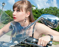 Attractive woman ride a black motorbike Royalty Free Stock Photo