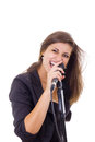 Attractive woman screaming on microphone singing Royalty Free Stock Photo