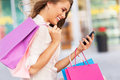 Attractive woman shopping young with mobile phone and bags Stock Image