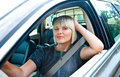 Attractive woman sitting in her car blond Stock Image
