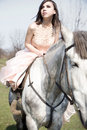Attractive woman is sitting on the horse Stock Photos