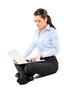 Attractive woman sitting with laptop on white Royalty Free Stock Photography