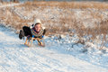 Attractive woman sledging downhill Stock Photo