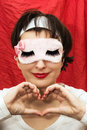 Attractive woman in sleep mask making heart shape with her hands caucasian sleeping Stock Photos