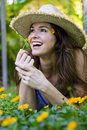 Attractive woman smelling a flower Royalty Free Stock Photos