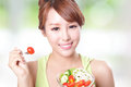 Attractive woman smile eating salad portrait of isolated on green background asian beauty model Stock Photography