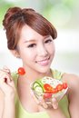 Attractive woman smile eating salad portrait of isolated on green background asian beauty model Royalty Free Stock Photos
