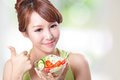 Attractive woman smile eating salad portrait of isolated on green background asian beauty model Royalty Free Stock Image