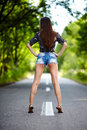 Attractive woman standing on the road beautiful young with back at camera Stock Photography