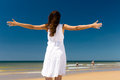 Attractive woman standing in the sun on beach Stock Photos