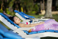 Attractive woman sunbathing at beach resort Royalty Free Stock Photo