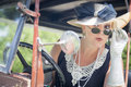 Attractive woman in twenties outfit checking makeu young makeup antique automobile Royalty Free Stock Photos