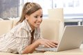 Attractive woman using laptop at home Stock Photos