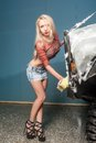 Attractive woman washing car pretty sexy offroad by sponge Royalty Free Stock Photo