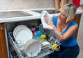 Attractive woman washing dishes Stock Photography
