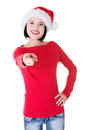 Attractive woman wearing santa hat is pointing isolated on white Royalty Free Stock Photo
