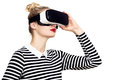 Attractive woman wearing virtual reality glasses. VR headset. VR concept on white background. Royalty Free Stock Photo