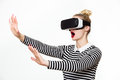 Attractive woman wearing virtual reality goggles. VR headset. Royalty Free Stock Photo