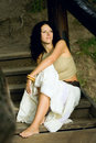 Attractive woman on wooden stairs Stock Photo