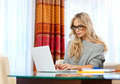 Attractive woman writing on laptop Stock Photos